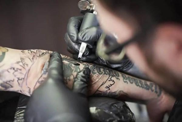 Man tattoo artist at work