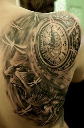 clock tattoo on right back shoulder