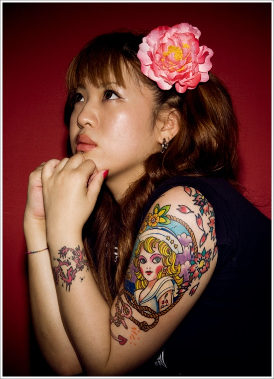 color ink asian tattoo on girl left half sleeve