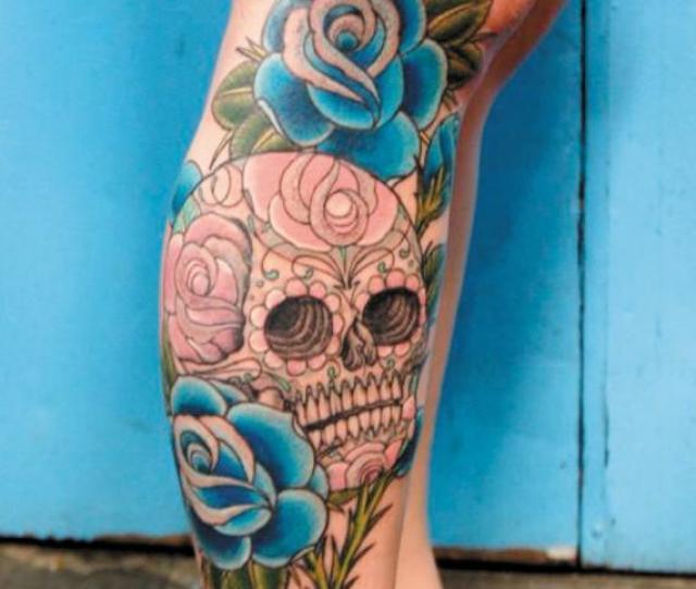 Blue Rose Flowers And Sugar Skull Tattoo On Right Leg