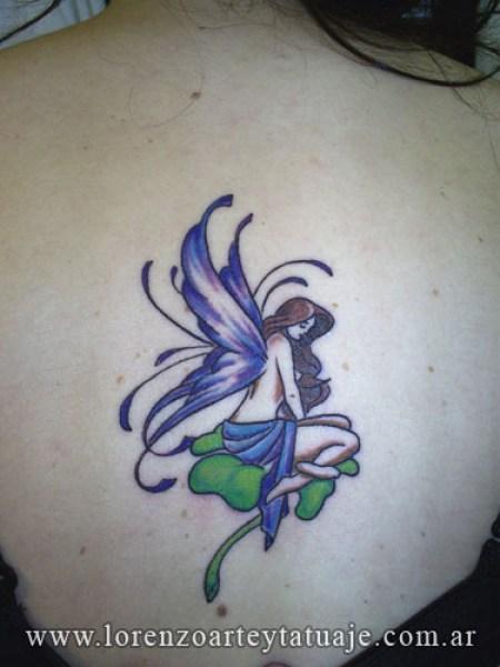 Hada alas violetas