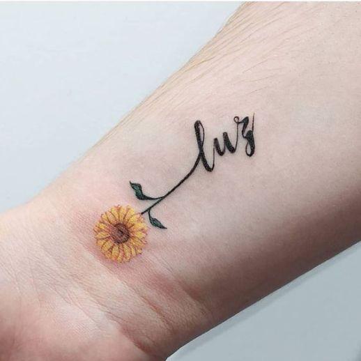 Frase: Luz y flor de girasol