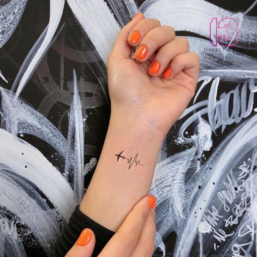 Electrocardiograma por Risha Tattoo