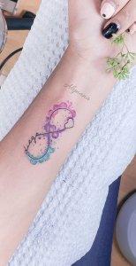 Signo infinito formado con el nombre: Diego y un Corazón por Alynana Tattoos