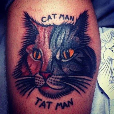 Cat man tattoo