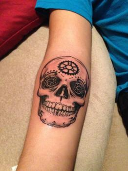 skull tattoo at forearm