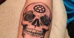 skull tattoo at forearm