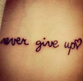 tatuaje never give up