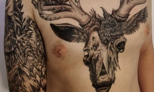 Chest and arm tattoo