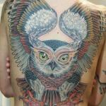 Owl tattoo at the back