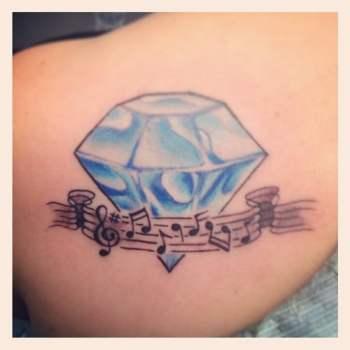 Diamond and music tattoo
