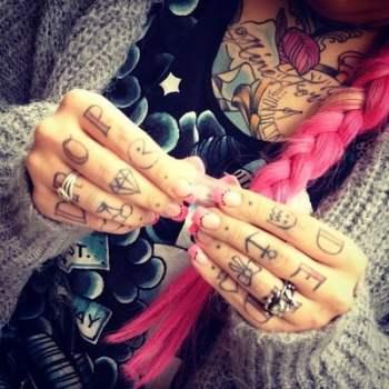 multiple tattoos on fingers