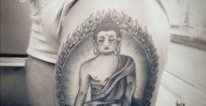 budha tattoo on thigh