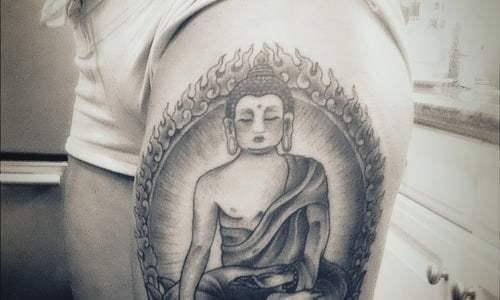 budha tattoo on thigh