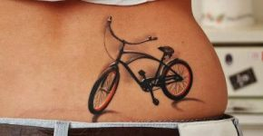 Bike tattoo on lower back