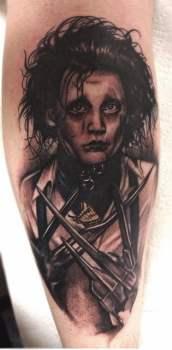 Tatuaje El Hombre Manos de Tijeras