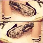 Tatuaje lobo en el muslo