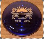 Blue glass paperweight with lodge emblem