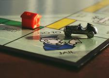 "Close up of the ""go to jail"" corner on the monopoly board"