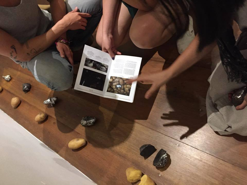 Explaining the making process for the Naked Potatoes.