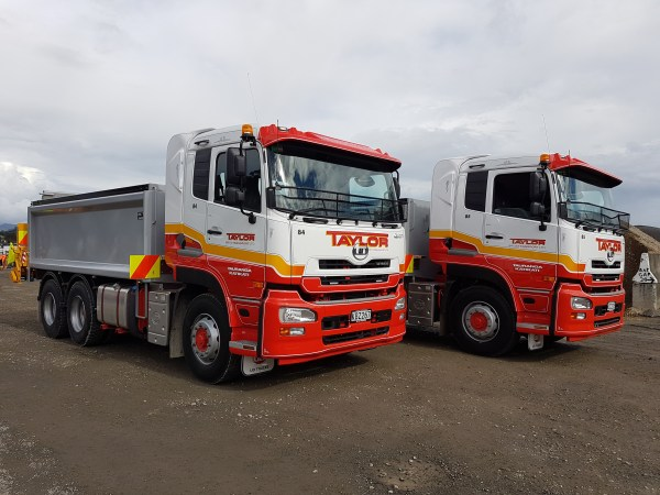2 new UD trucks fitted with remote controlled roller spreaders