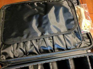 """To protect your brushes and pencils, the case includes a fold-over flap that completely covers them. Also, the case includes a small """"sandwich zipper compartment."""" I'm using it to store rollers and cosmetic removal wipes."""