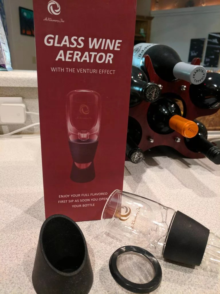 The AKHomery Vinturi Aerator comes with a stand and a sieve to catch sediment