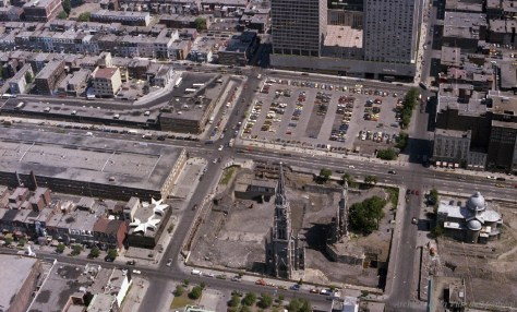 The bell tower of the former Saint Jaques Cathedral and the parking lot that preceded Place Emilie-Gamelin, 9th of June 1976. Photo by Vincent Massaro, credit to Archives de Montréal