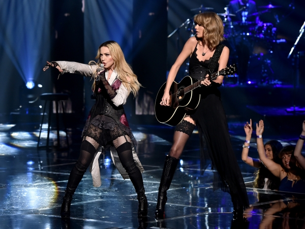 Taylor Swift and Madonna dressed in black stockings to perform