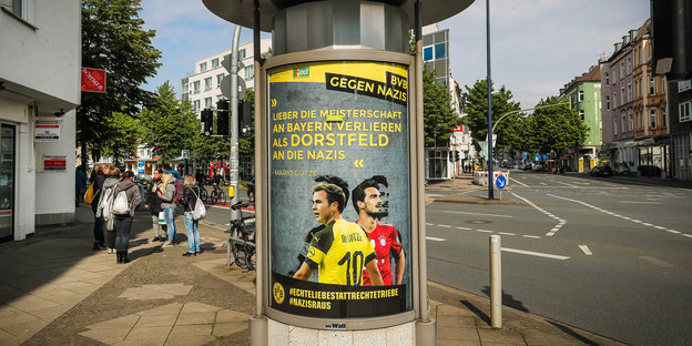 Poster on a advertising pillar. It says: Dear lose the championship to Bayern as Dorstfeld to the Nazis