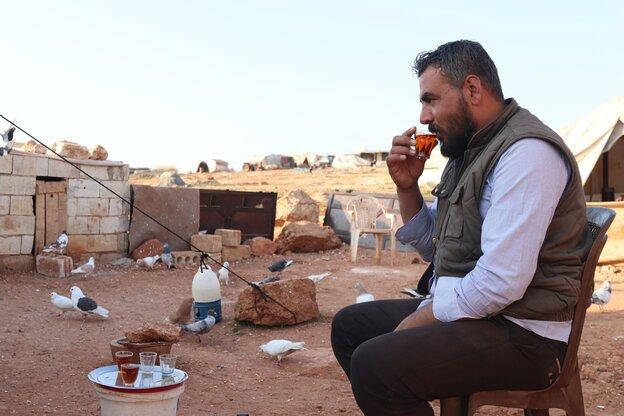 A man is drinking tea