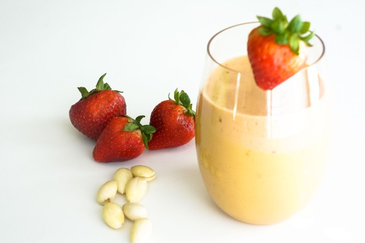 apricot smoothie in a stemless wineglass