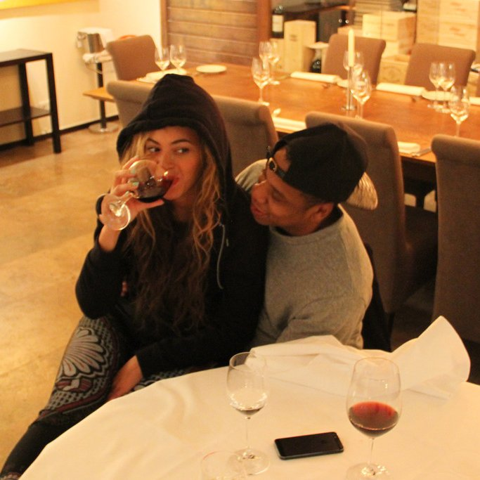 Beyonce drinking wine with celebrities