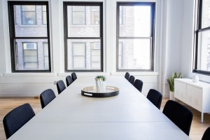 image of empty conference room to illustrate summer slowdown