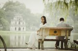 Couple sitting in bench