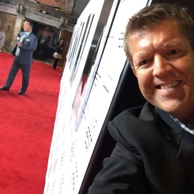 "David Jahr, editorial advisor for Neuro-Laser Foundation, takes a ""selfie"" from the red carpet, literally behind-the-scenes for the World Premiere of the movie ""Concussion,"" featuring Will Smith."