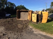 Dump Truck Overturns, Spilling Dirt on U.S. 301