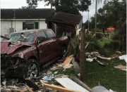 Truck Hits House, Injures Woman Inside