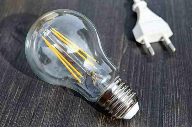 a lightbulb and a plug on a table
