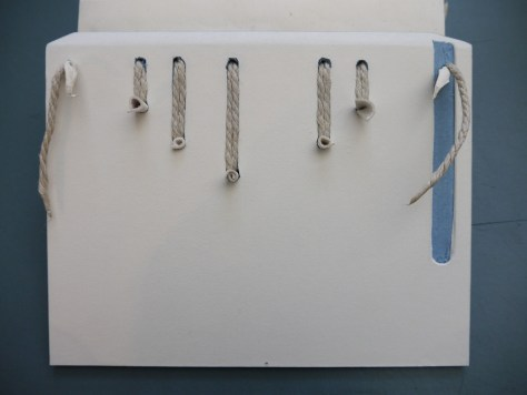 Fig. 3 Sewing cords laced into channels cut in the board.