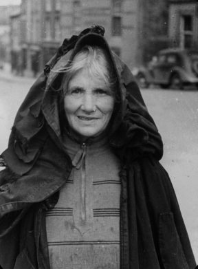 TCD MS 10842/1/408 Woman wearing an Irish cloak, Macroom, Co Cork, 1936