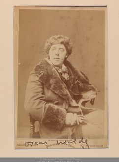 TCD MS 11437/2/1/3: Portrait photograph of Oscar Wilde by Robert W. Thrupp, Birmingham [1884]. Autographed by OW.