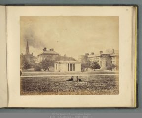 View from Fellows' Square, (1870s?); includes Provost's House and Gardens, Magnetic Observatory, the rear of the Public Theatre, students lounging on the lawn, archery target, several trees (TCD MUN MC 157/14)