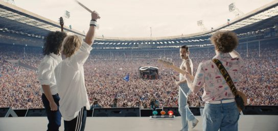 Gwilym Lee (Brian May), Ben Hardy (Roger Taylor), Rami Malek (Freddie Mercury), and Joe Mazzello (John Deacon) in BOHEMIAN RHAPSODY.