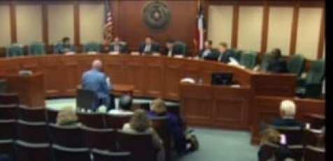 Dr. Paul Dunn testifying before a legislative committee