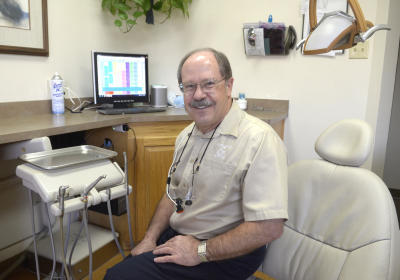 """For the single guy on the corner it's going to be very difficult to compete any more,"" dentist Robert Gherardi, says.  (Dean Hanson/Albuquerque Journal)"