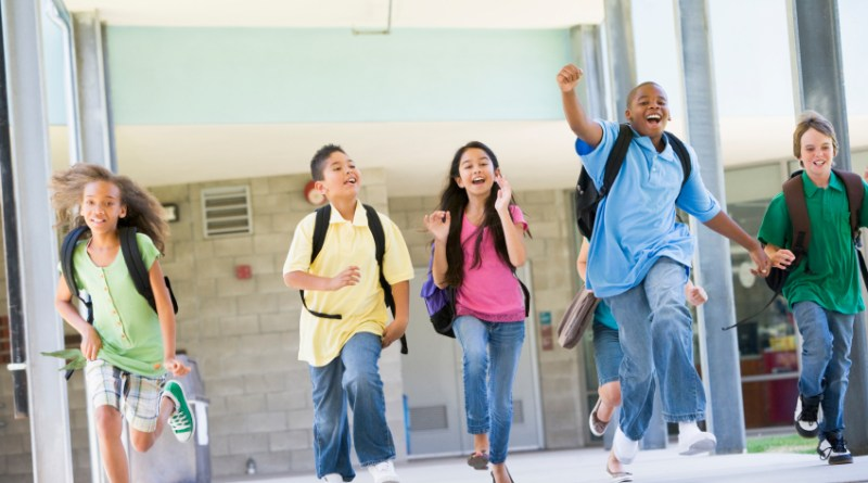 Elementary school pupils running