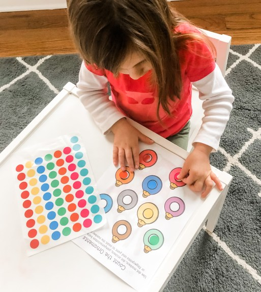Use these free printable Christmas dot activity pages to practice fine motor and visual motor skills with your toddler or preschooler.