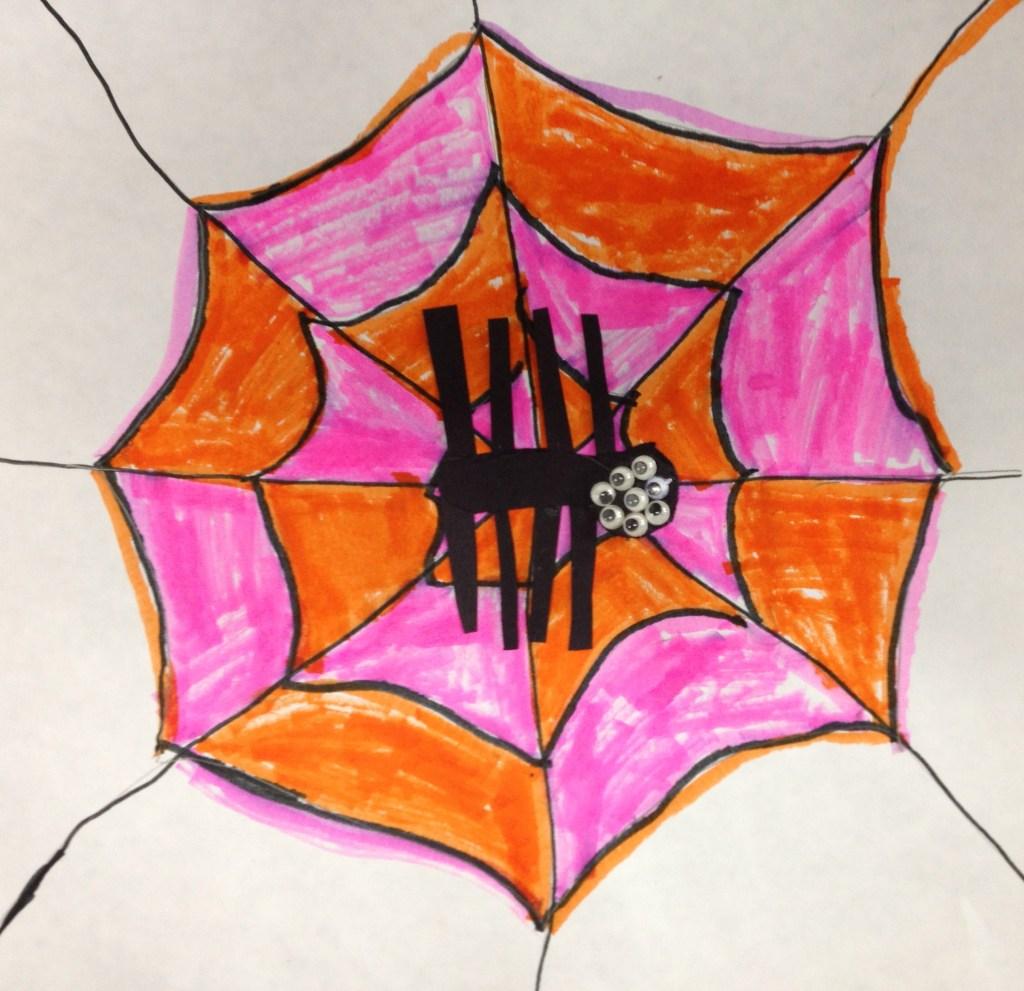 Orange and pink spiderweb with spider