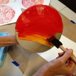 Spread a thin layer of paint onto circle